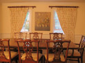 Drapes on decorative hardware for dining room windows in Westchester, New York