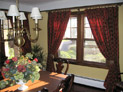 Drapes on decorative hardware for dining room windows in Long island, New York