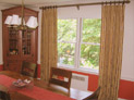 Drapes on decorative hardware for living room windows in Westchester, New York